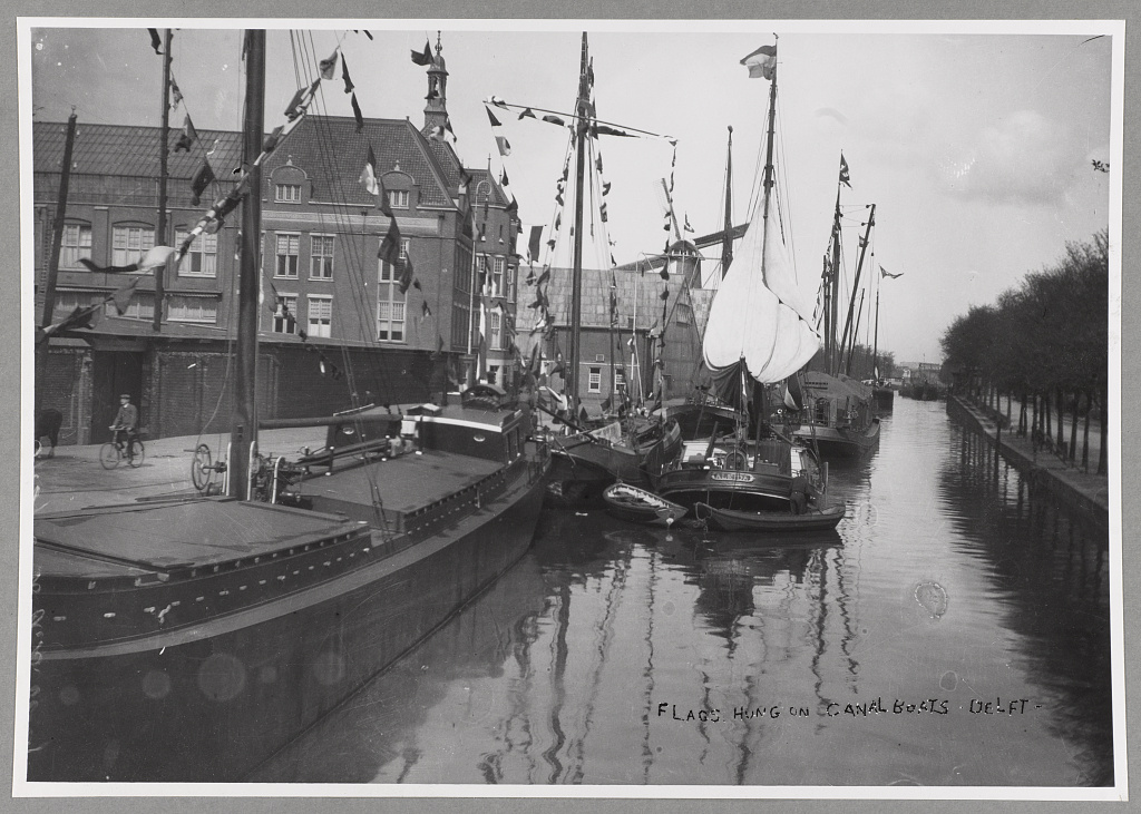 Flags hung on canal boats. T. R. Roosevelt, Delft, Holland.