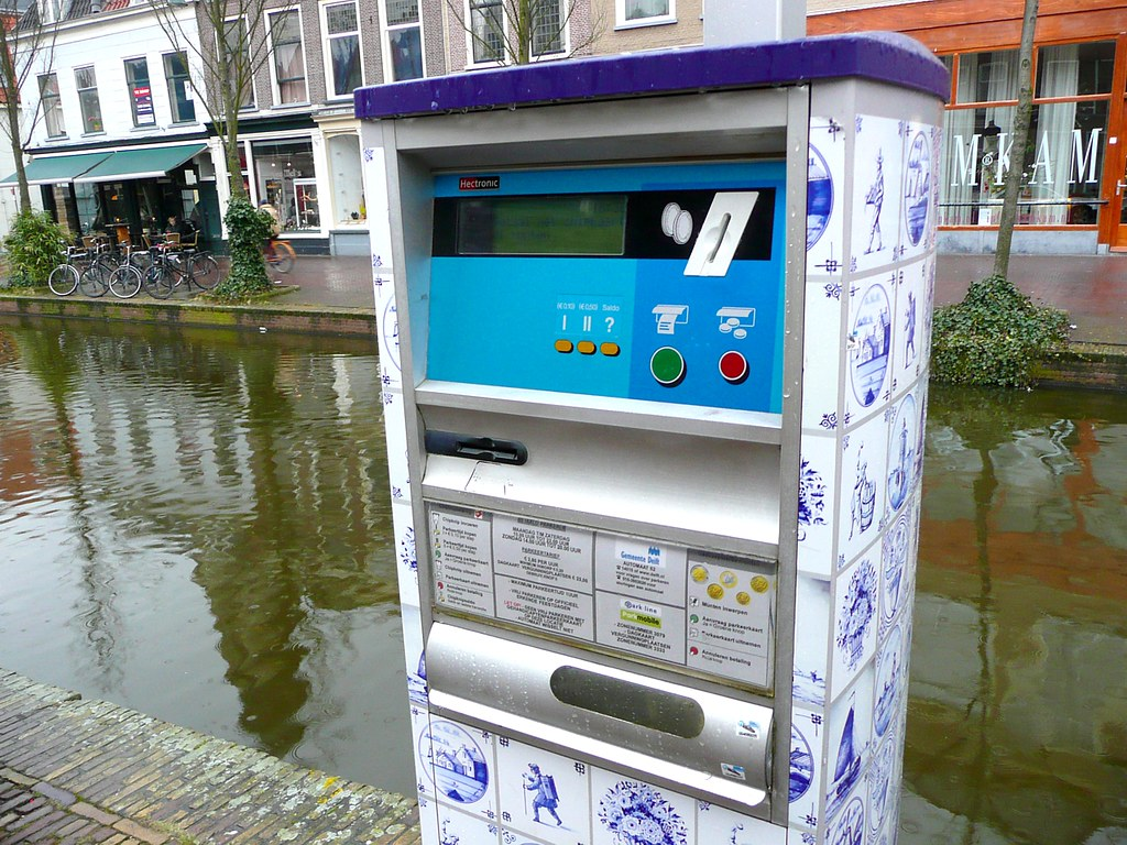 parking ticket machine covered in delft tiles